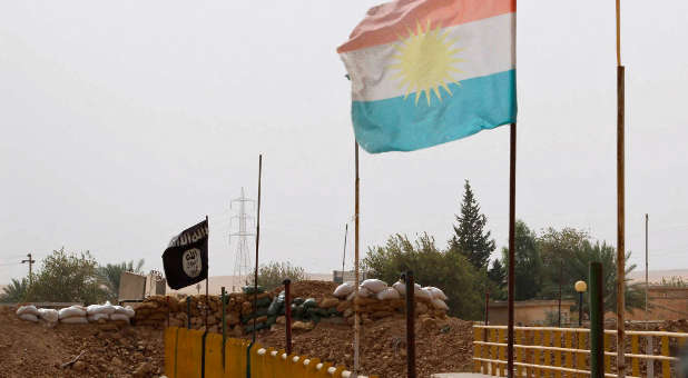 Islamic State and Kurdish flags