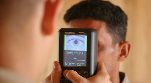 A soldier undergoes a biometric scanning process.