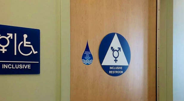 A gender-neutral restroom sign. The White House has opened it's first gender-neutral restroom.
