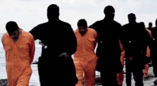 Islamic State fighters walk 21 Coptic Christians to their execution spot.