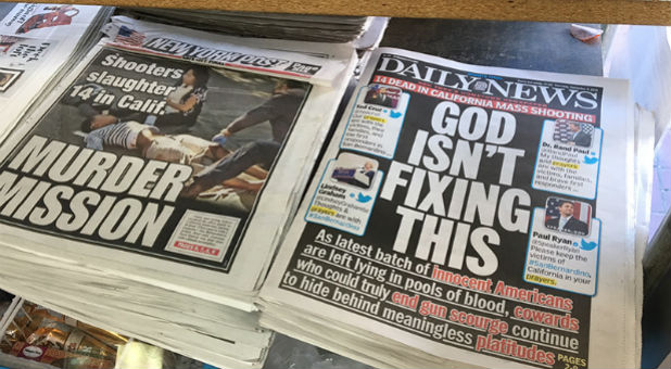 The New York Daily News front cover reads 'God Isn't Fixing This' sits on news stands in Brooklyn, New York on December 3, 2015.