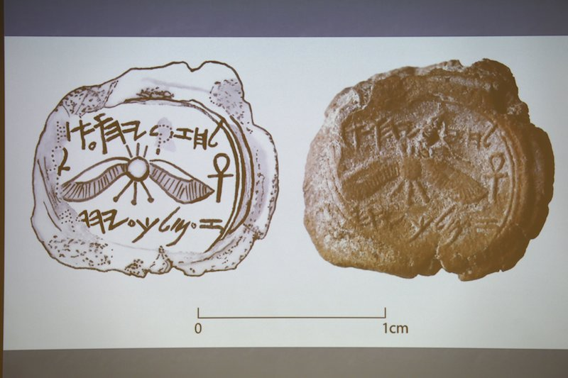 A projected image of a clay imprint, known as a bulla, which was unearthed from excavations near Jerusalem's Old City, and later discovered to be from the seal of the biblical King Hezekiah, is displayed during a news conference at The Hebrew University in Jerusalem.