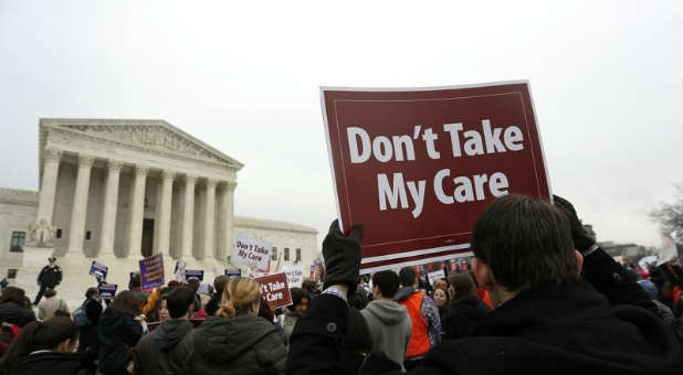 Demonstrators gather outside the Supreme Court during the Obamacare ruling.