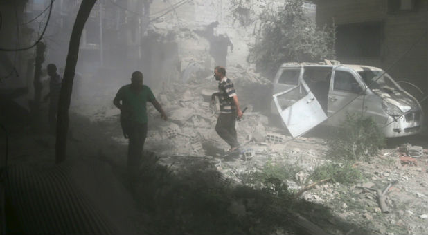 Residents inspect damage from what activists said was an airstrike by forces loyal to Syrian President Bashar al-Assad on the town of Douma, eastern Ghouta in Damascus.