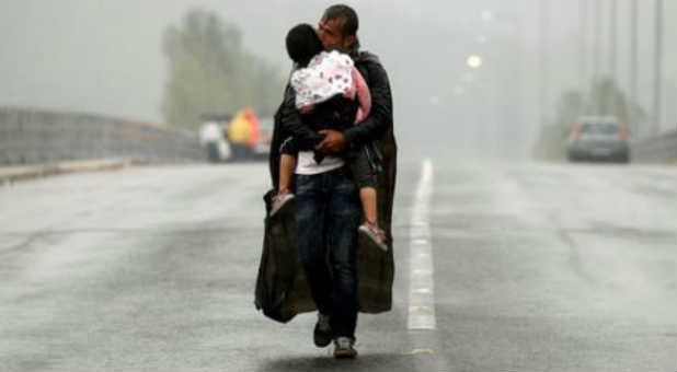 A Syrian migrant wanders through Europe with his son.