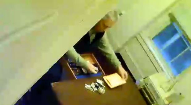 Security footage shows a pastor rifling through church collections.