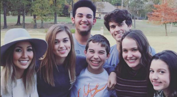 Willie and Korie Robertson's children, including the boy they're adopting (center).