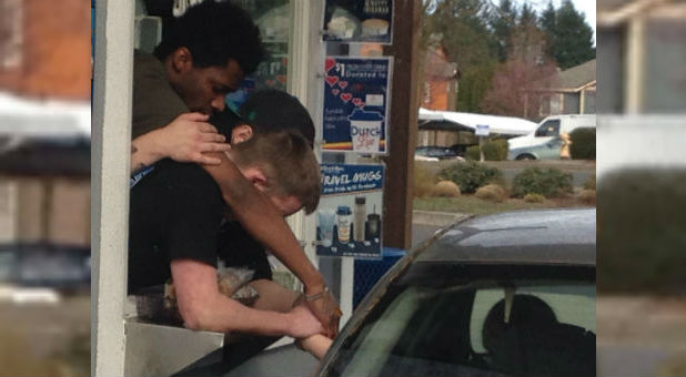 Dutch Bros Coffee employees pray for a woman in the drive-thru