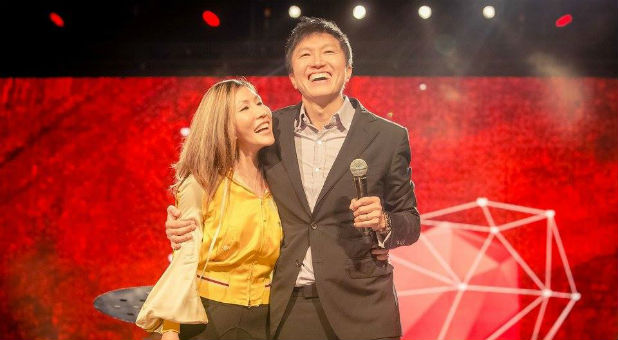 Pastor Kong Hee with his wife Sun Ho.