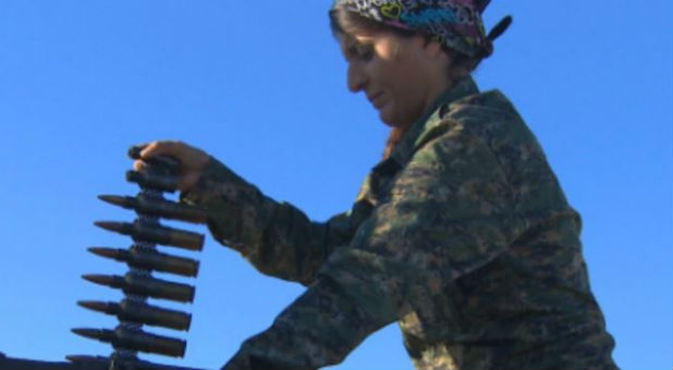 A female fighter prepares for battle with ISIS.