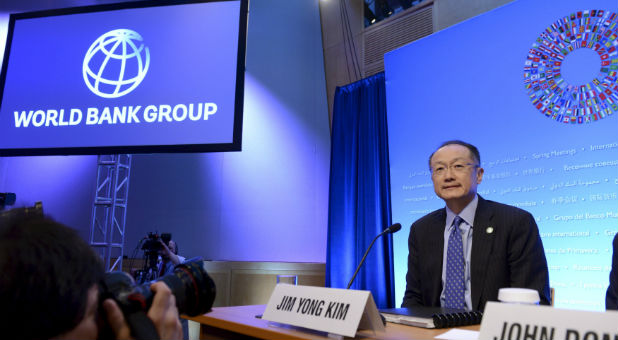 World Bank President Jim Yong Kim takes his seat as he arrives to brief the press at the opening of the IMF and World Bank's 2015 Annual Spring Meetings