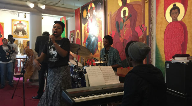 "The Rev. Marlee-I Mystic sings vocals, left, while Landres King plays drums and Franzo King III plays the keyboard during the ""A Love Supreme"" Mass at the St. John Coltrane Church in San Francisco."
