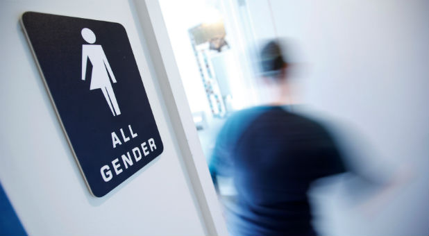 A bathroom sign welcomes both genders at the Cacao Cinnamon coffee shop in Durham North Carolina.