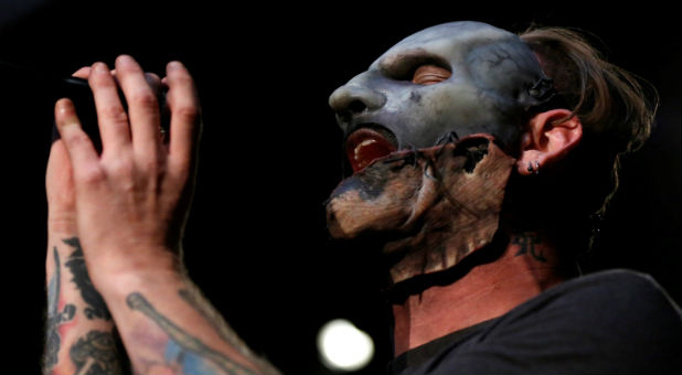 "Corey Taylor of Slipknot performs after a news conference to announce the ""Ozzfest Meets Knotfest"" music festival at the Hollywood Palladium in Los Angeles."