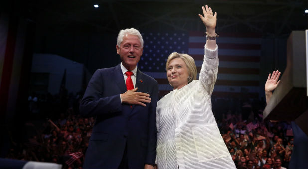 Former President Bill Clinton joins wife Hillary Clinton to celebrate her historic win.