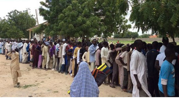 Internally displaced people queuing for relief materials in Maiduguri, Borno State.