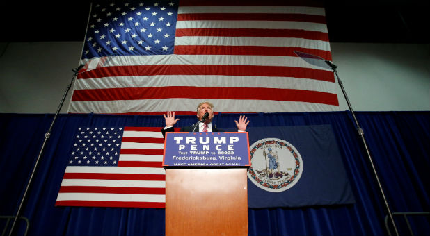 Republican presidential nominee Donald Trump speaks on stage during a campaign rally