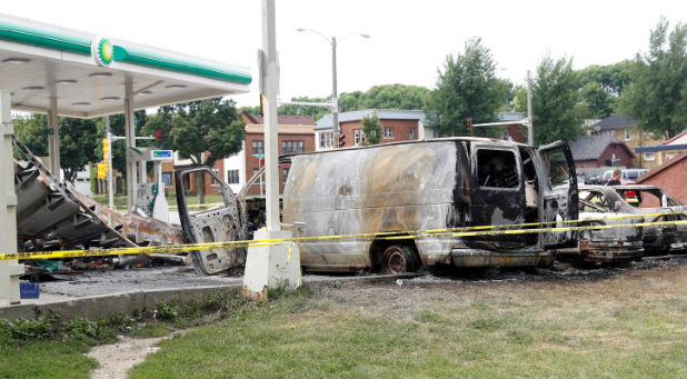 A burned down gas station is seen after disturbances following the police shooting of a man in Milwaukee, Wisconsin