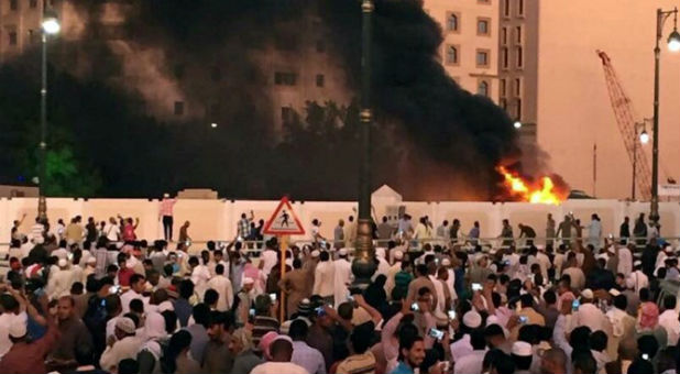 Muslims gather to pray just after a suicide bombing attack in Saudi Arabia.