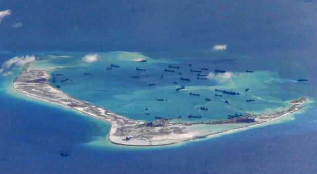 Chinese dredging vessels are purportedly seen in the waters around Mischief Reef in the disputed Spratly Islands in the South China Sea