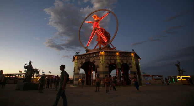 The Man is illuminated as approximately 70,000 people from all over the world gather for the 30th annual Burning Man arts and music festival in the Black Rock Desert of Nevada