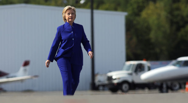 U.S. Democratic presidential candidate Hillary Clinton walks to board her campaign plane