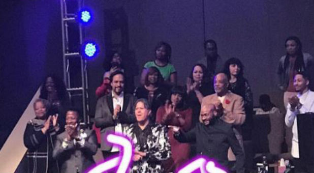 Bishop Eddie Long, first row right, returns to New Birth Missionary Baptist Church.