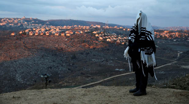Jew Wearing a Prayer Shawl on Hill Overlooks West Bank Settlement