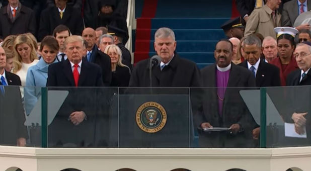 Evangelist Franklin Graham prays at the inauguration.