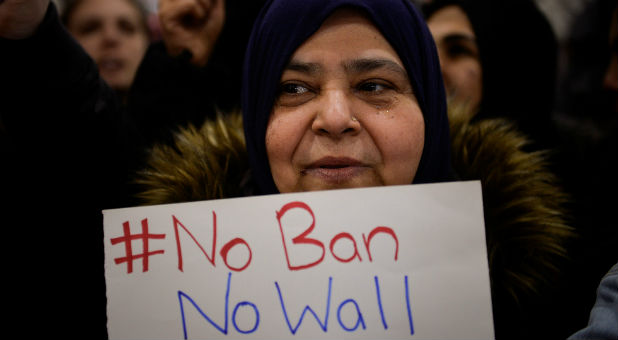 A Muslim women holds a sign during anti-Donald Trump travel ban protests outside Philadelphia International Airport in Philadelphia, Pennsylvania