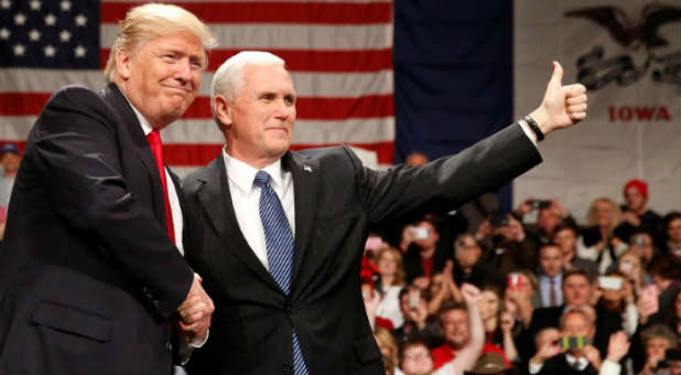 U.S. President-elect Donald Trump shakes hands with Vice President-elect Mike Pence at the USA Thank You Tour event at the Iowa Events Center in Des Moines, Iowa.