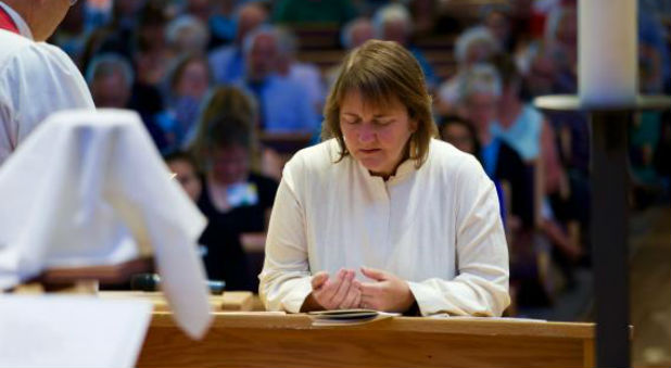 Lesbian Bishop Karen Oliveto was consecrated and ordained last summer.