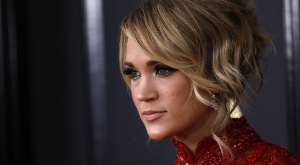 "On one of the largest stages in the nation, Carrie Underwood was invited to participate in the latest Passion Conference. She belted out ""Amazing Grace"" alongside Crowder in front of thousands of worshippers. What many didn't realize is Carrie is a supporter of homosexual rights."