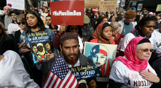 "People take part in an ""I am Muslim Too"" rally in Times Square, Manhattan."