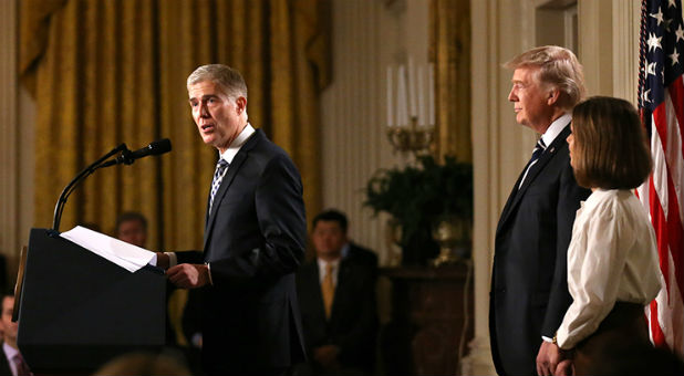 Judge Neil Gorsuch, left, speaks as President Donald Trump stands with Gorsuch's wife, Marie Louise, after Trump nominated Gorsuch to be an associate justice of the U.S. Supreme Court