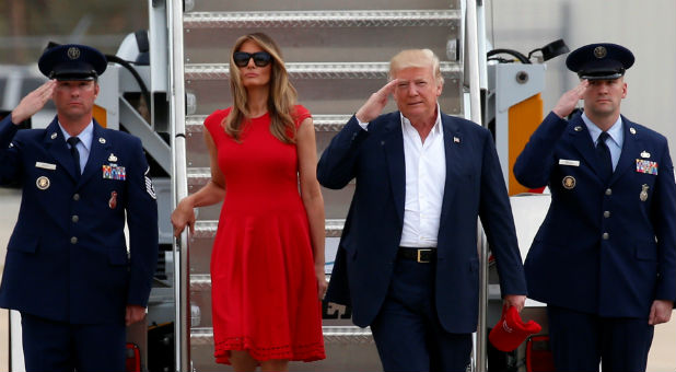 "U.S. President Donald Trump and first lady Melania Trump step from Air Force One to attend a ""Make America Great Again"" rally at Orlando-Melbourne International Airport in Melbourne"