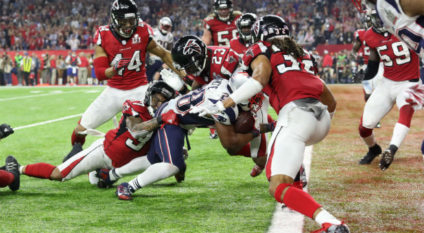 New England Patriots' James White scores a touchdown during overtime to win Super Bowl LI against the Atlanta Falcons.