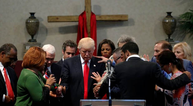 Praying over President Donald Trump