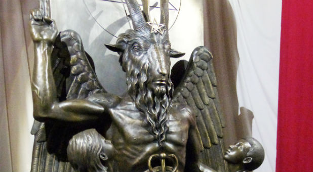 A one-ton, 7-foot (2.13-m) bronze statue of Baphomet --a goat-headed winged deity that has been associated with satanism and the occult --is displayed by the Satanic Temple