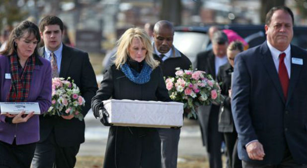 Linda Znachko prepares for a graveside service for one of the babies.