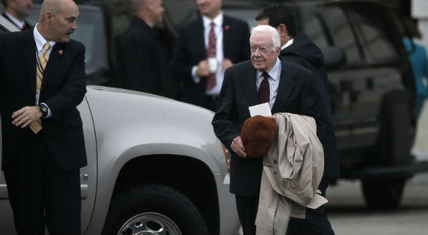 Former U.S. President Jimmy Carter departs the Capitol after attending the presidential inauguration of Donald Trump