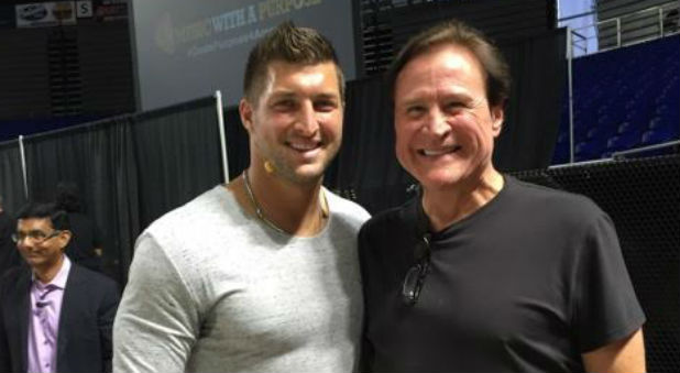 Tim Tebow and Larry Tomczak