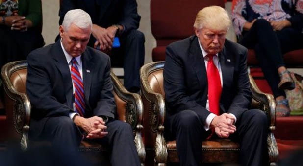 president donald trump and vice president mike pence praying