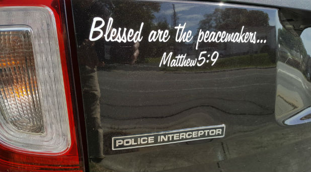 "Their attorney told them ""the decals would be a violation of the First Amendment based on the current case law because of the reference to Matthew 5:9."""