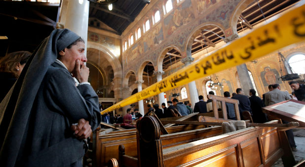 A nun cries as she stands at the scene inside Cairo's Coptic cathedral, following a bombing