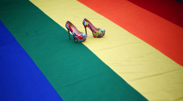 High heel shoes are seen on a rainbow flag during a protest by the LGBT community.