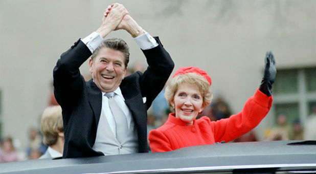 Ronald and Nancy Reagan wave from the limousine during their inaugural parade in Washington, D.C., U.S. in January 1981.