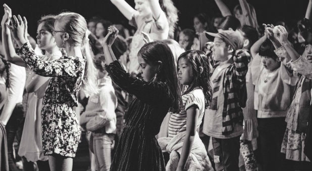 Children worship at a Hillsong event.
