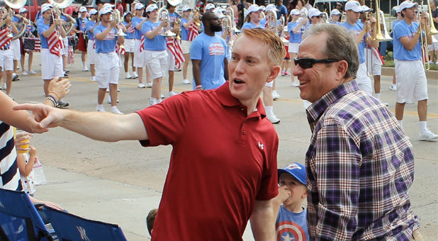 U.S. Sen. James Lankford, R-Okla., visits with constituents during the LibertyFest parade on the Fourth of July in Edmond, Oklahoma, north of Oklahoma City.