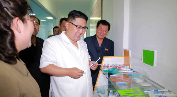 North Korean leader Kim Jong Un visits the newly-built Dental Sanitary Goods Factory.
